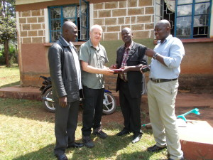 Photo of the teachers receiving the equipment