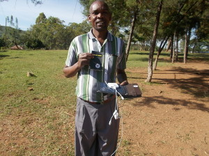 The head teacher with all the pieces to power and use the kindle at their rural school